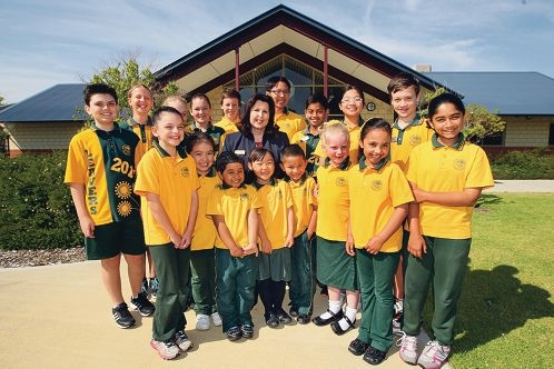 Principal Julie Roberts with some students at the outstanding Wattle Grove Primary School.