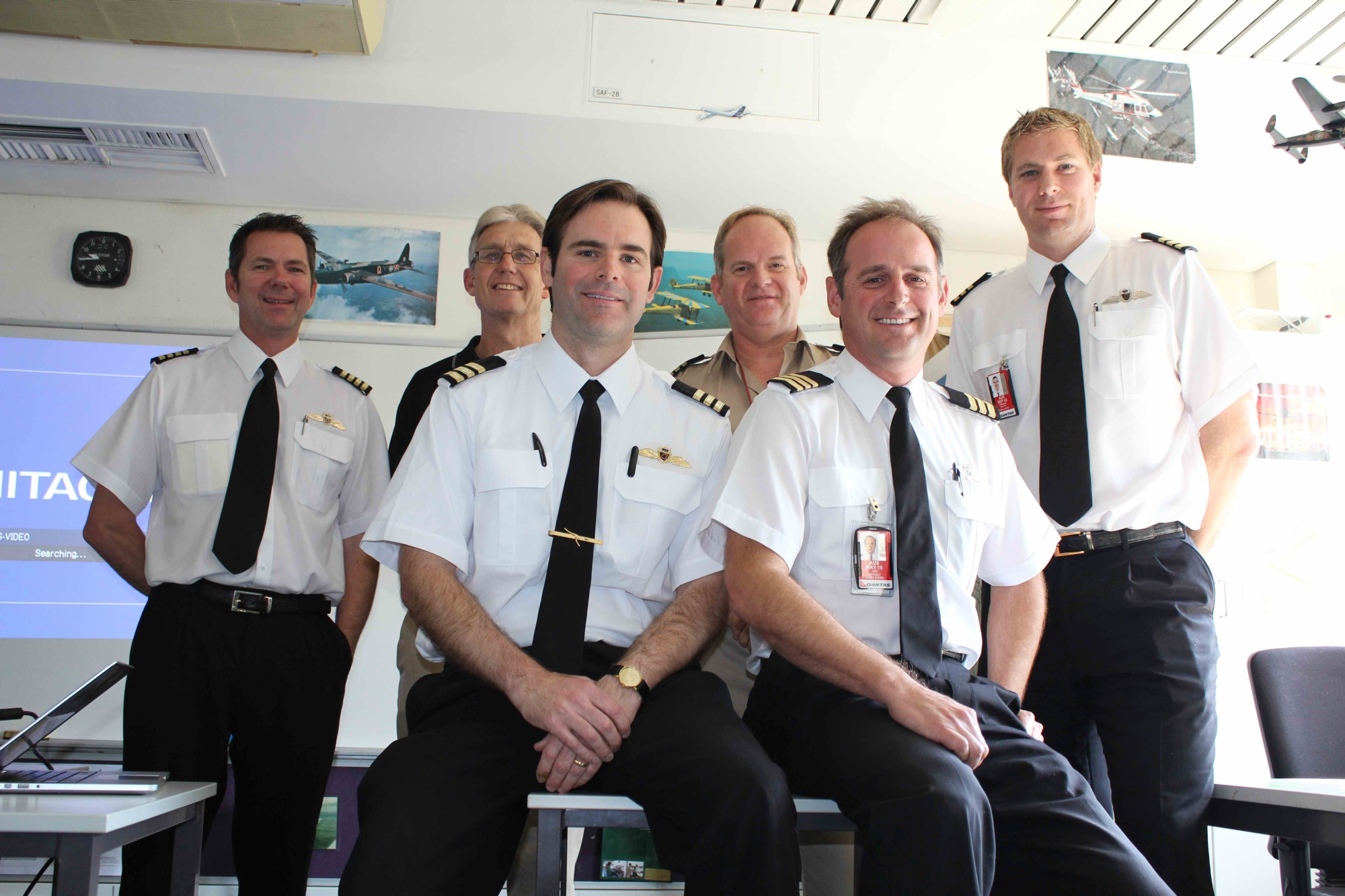 Capt Yale Simpson (1988 graduate), Aviation teacher Brendan Wallis, Capt Stuart McWilliam (1995 graduate), Aviation program coordinator Randall Brink, Capt Joe Metcalf (1988 graduate), Capt Graham Watts (1997 graduate). Picture: Emma Clayton