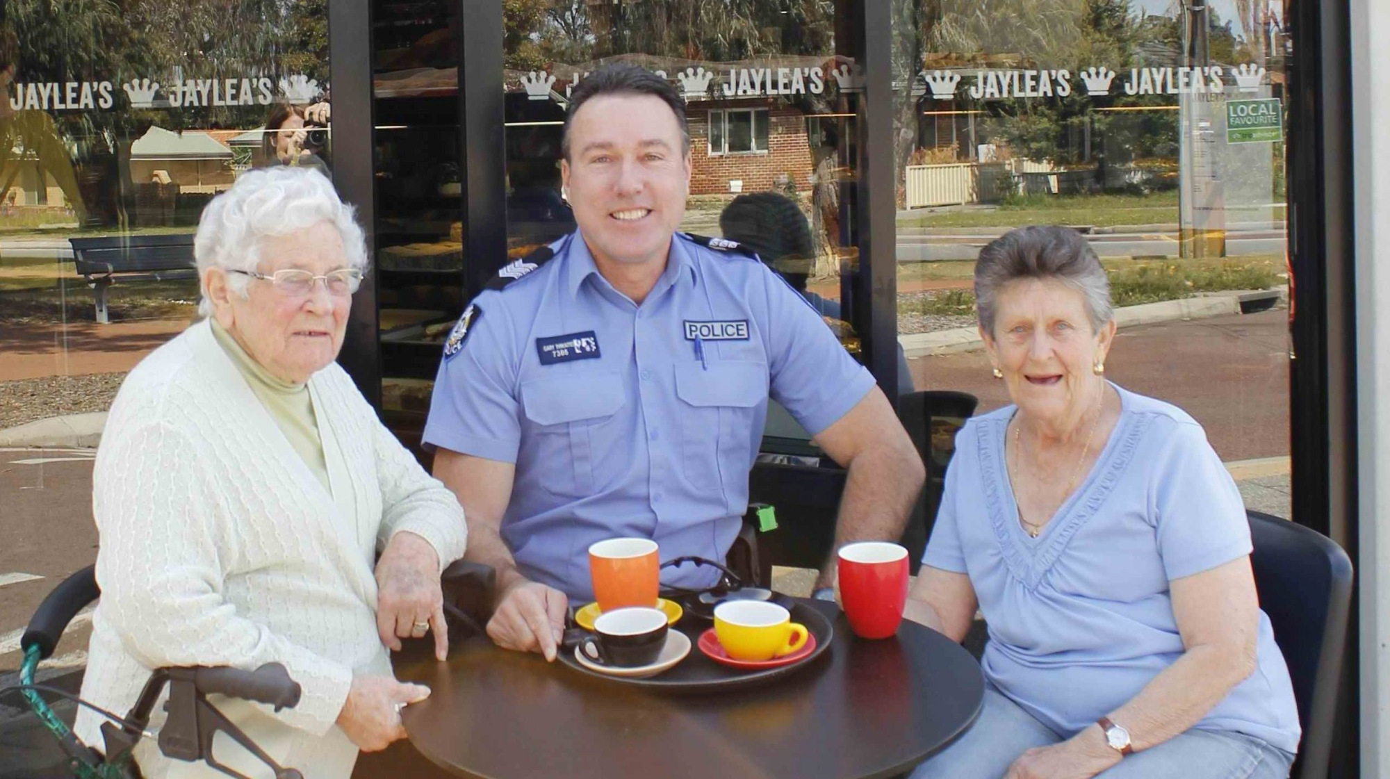 Sgt Gary Thwaites shares a coffee with Willagee residents Betty and Wendy. Picture: Emma Clayton