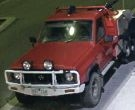 A red Nissan patrol believed to have been used in a burglary.