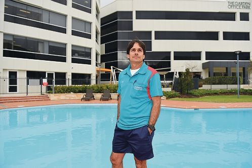 PoolWerx Balcatta and City Beach franchise partner Mike Hamil-Smith with a pool he maintains at The Garden Office Park in Osborne Park [NAMES OK]
