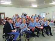 The Northern Suburbs Stroke Support Group members with their poppies.