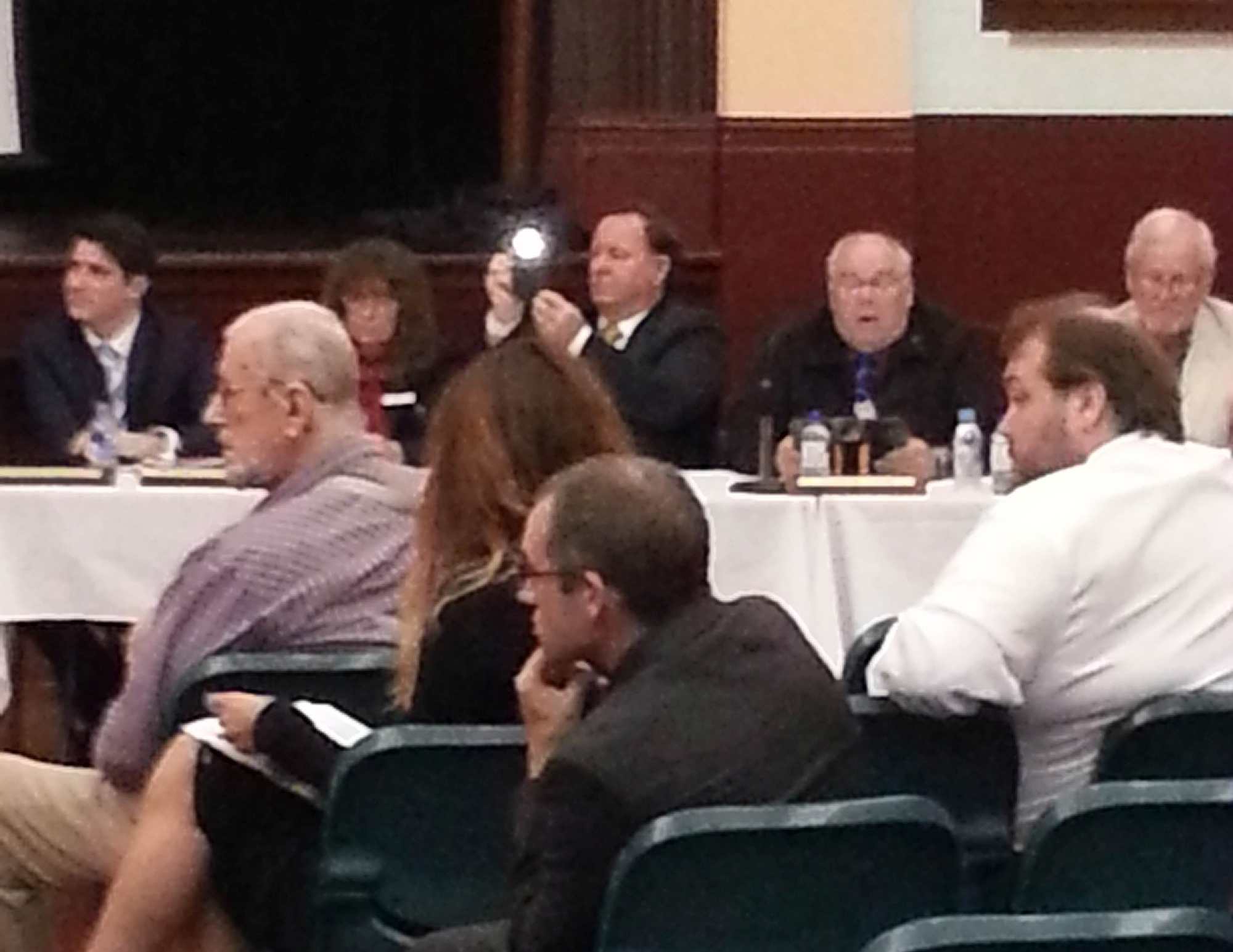 Councillor David Fardig takes a photo at last Monday's special electors meeting.