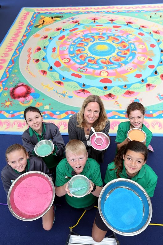 Artist Nicole Andrijevic (centre, back) with students (from left) Jaime Arlow, Trinity Gordon, Slade Scherini, Molly-Rose Prince and Mali-Star Burns. Picture: Emma Goodwin d426595