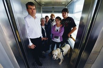 MLA Dave Kelly with local residents Shirley Jeffries, Joan Park, Loretta Lynes, Shelby Fink and Damien MacKenzie with his seeing eye dog Nina in one of three lifts at Bassendean station. Picture: Marcus Whisson