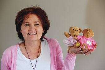 Michele Librizzi says support Cancer Council research, prevention programs and support groups by buying gifts like these two cute bears from its Pink Ribbon Range. d426454