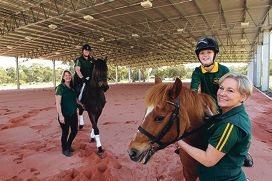 Orange Grove Horse and Pony Club members Karen Hardy with Mardie Johnson on Whizz, and Ebony Johnson on Miss Molly with Jill Claybrook. Picture: Marcelo Palacios d426384