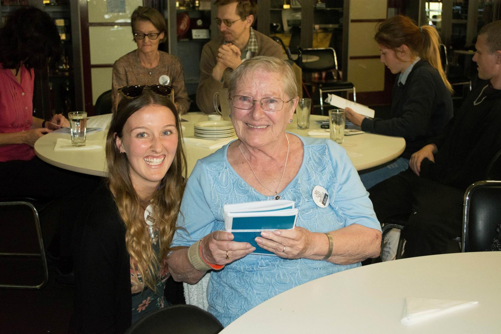Volunteer biographer Jade O'Sullivan with Alice Bruyns.