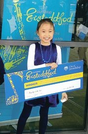 Bryzlyn Sin proudly collects her music award from Eisteddfod.