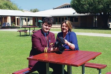 Short film finalist Rory Henderson with media teacher Melissa Farrell in the grounds of St Mark's Anglican Community School.