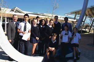 Principal Armando Giglia with students Murtaza Mohammadi, Chloe |McCabe, Ryan Duncan, Sasha Phillips, David Brooke, Emma Michell, Sean Wills, science teacher Bryan Rodrigues, and seated, Solomon Camilleri-McDonald, Lily Smetherham and Charlotte Kaltenrieder.