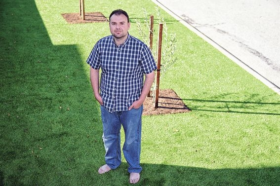 Dianella resident Serge Hayon standing on the front verge, made up of artificial lawn. Picture: Marcus Whisson www.communitypix.com.au d426234