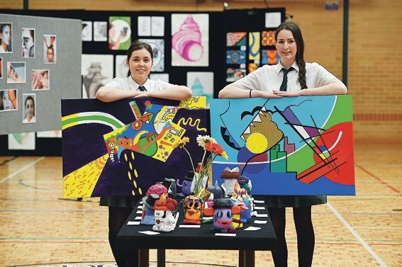 Servite College Year 12 visual arts students Taylor Gullotti and Sophie Walsh with their artworks.