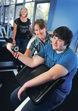 Heather Brooke watches son Brad exercise with help from Julia Hendley of Belmont Oasis Leisure Centre.