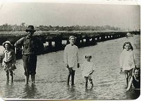 A group standing in the water near Attadale Jetty in 1914.