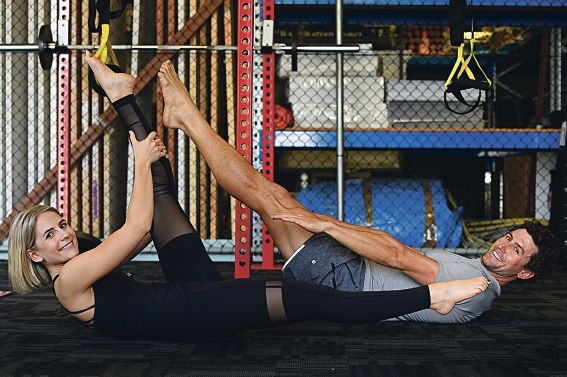 Pilates instructor Sophie Ntoumenopoulos with client and ironman Aaron Williams.