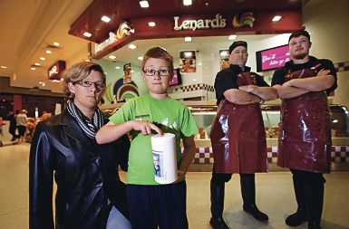Mother Nicole Gangemi with her son Anthony (9), who had the charity tin he placed at Lenard's stolen, with Lenard's owner Russel Keep and store manager Matt Heseltine.
