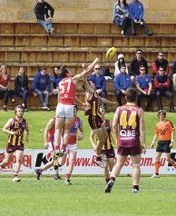 West Perth's Blake Wilhelm launches for a punch on the ball. Picture: Dan White