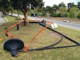Car knocks down light pole