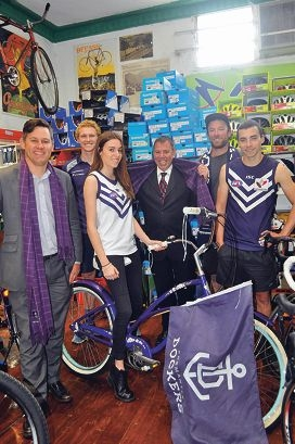Fremantle Mayor Brad Pettitt, Jackson Shaw, Sara Mercer, Fremantle Chamber of Commerce chief executive Tim Milsom, Luke Golden and Fletcher Hampson of Mercer Cycles, last year's window decoration winner.