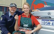 Senior Constable Eric Van Der Kooij and Leanne French, Bunnings activity organiser, with an anti-theft number plate screw. Picture: Martin Kennealey