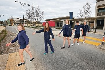 Students Bridget Fitzmaurice, Chloe Dawe, Hannah Fooks, Saxon Dearlove and Hayden Smith have been told that Ellenbrook Secondary College will be getting flashing lights for the school crossing.