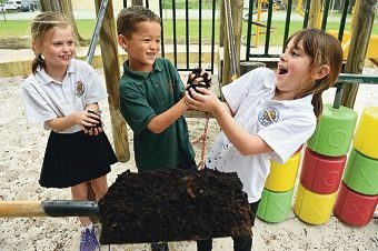 Nothing to sniff at... Coolbinia Primary School students Matilda Stephens, Christopher Boudville and Hannah Hoogland handling the fertiliser. Picture: Marcus Whisson d425639