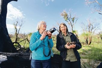 Friends of Underwood Avenue Bushland's Margaret Owen and Heidi Hardisty fear for the future of Carnaby's black-cockatoo. Right: A pair of the birds at Underwood Avenue. Picture: Andrew Ritchie www.communitypix.com.au d425611