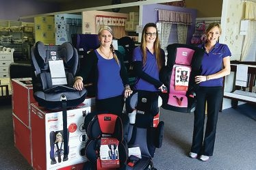One Stop Baby Shop in Port Kennedy owner Jill Edwards, Kylie Saw and Kirsty Brown with some child car seats.