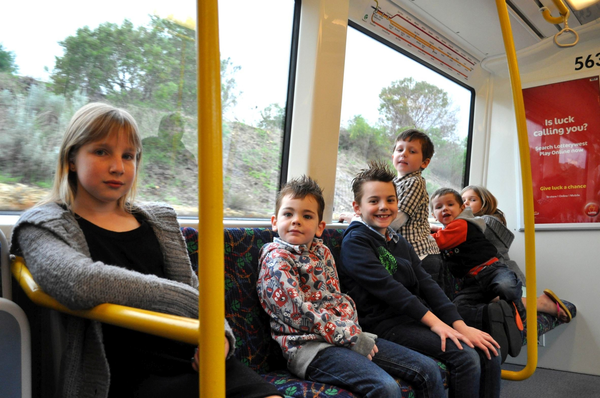 Suzanne de Wit, Matthew and Connor Malan, Ronan and Thomas Grealish and Danielle de Wit enjoy an early train ride.