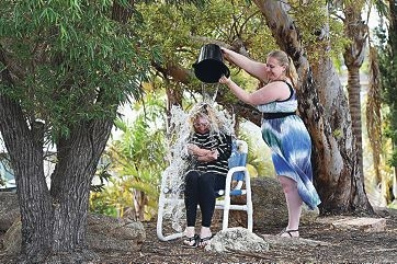 ALS sufferer Zoie Fenner-Dale pours a bucket of ice-cold water over her mother Tania Whittaker-Wilson as part of the ALS ice bucket challenge. Picture: Marcus Whisson d425241