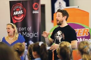 WA Opera singers Lucy Mervik and Jonathan Brain conduct a vocal workshop at St Paul's Primary School.