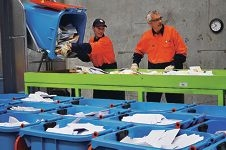 Staff at CTI Logistic in Bibra Lake shred the intercepted scam letters.