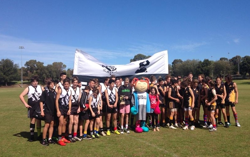 Players from Wanneroo and Ocean Ridge with Kalin Foley holding the cup.