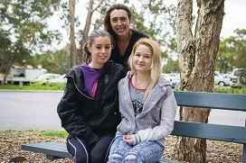 Deb Monteith with two local teenagers.