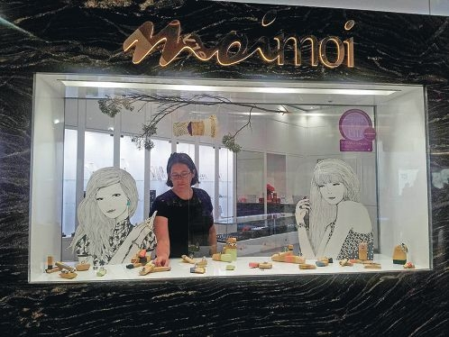 Alicia Rogerson putting the final touches to her window display.