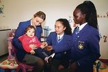 Year 11 student Julia Cataldo holding Mikayla Carroll with Kim Robinson and Pakete Kot.