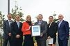 Ben Jarvis (Water |Corporation), North |Metropolitan Region MLC Peter Katsambanis, Water Minister Mia Davies, Antony Rowbottam (Lend Lease), Erin Abbott (LandCorp) and Paul McQueen (EnviroDevelopment) with the Waterwise certification.