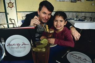Publisher Scott Arnold-Eyers and his daughter Jade (6) enjoy a tiramisu at Cafe Del Pescatore in Scarborough [NAMES OK]