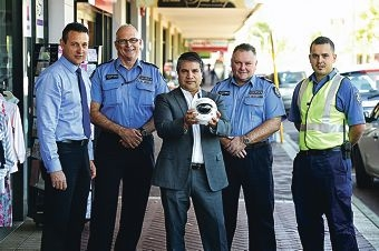 Officers from the Bayswater and Morley police stations with City of Bayswater Mayor Sylvan Albert, seen here with a CCTV device. Picture: Marcus Whissond424548