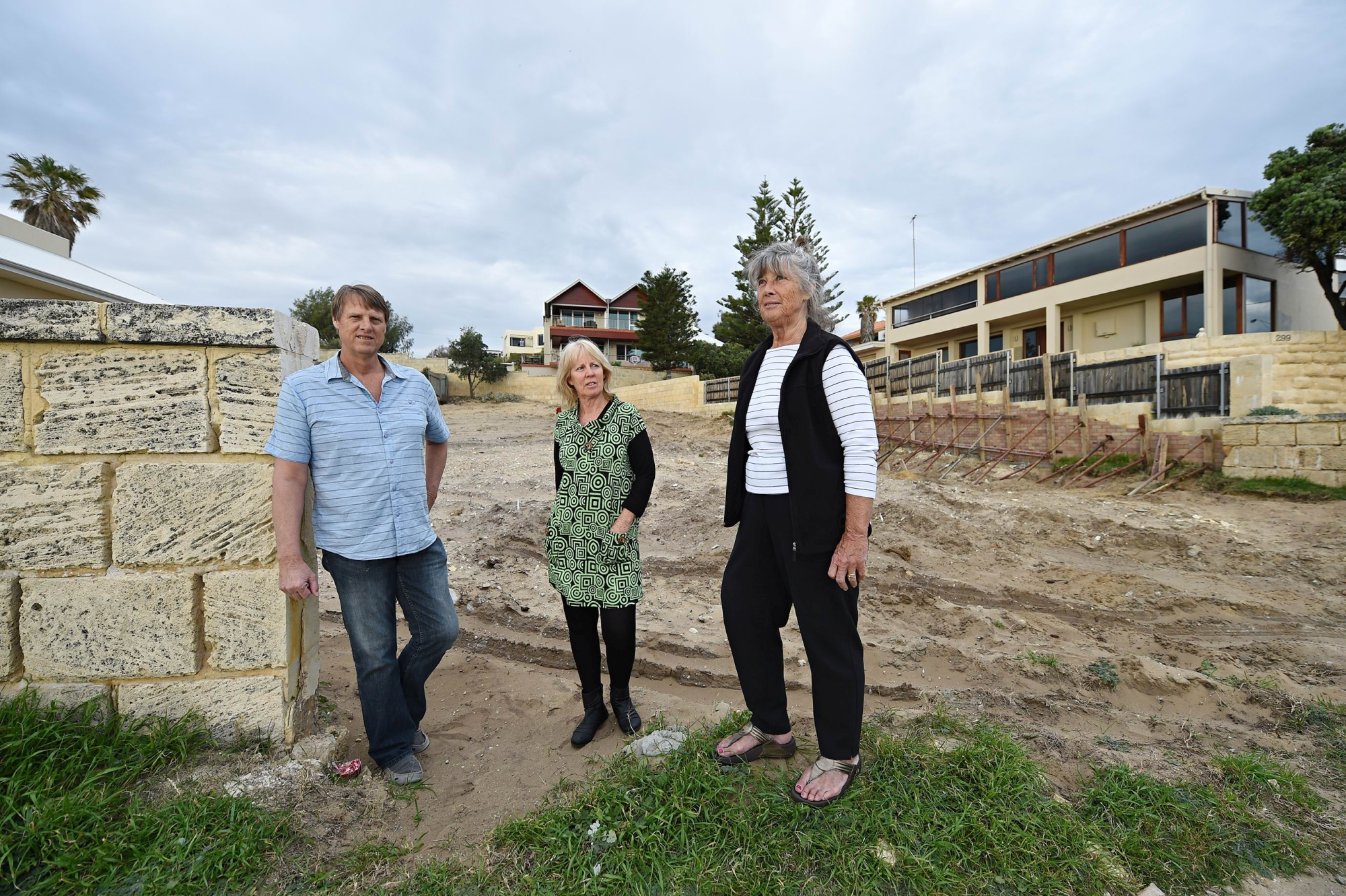 From left: Mike Deephouse, Glenda O'Riley and Rose Hawke at the site where Gull Cottage once stood. Picture Marcus Whisson d424479