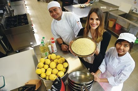 Rhiannon Birch with a bowl of the superfood lupin with hospitality students Sione Veilofia and Kristhel Gruco.|Picture: Marcus Whisson www.communitypix.com.au d424477