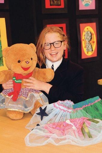 Ella Van Leeuwen with an example of her tutu creations for teddy bears.