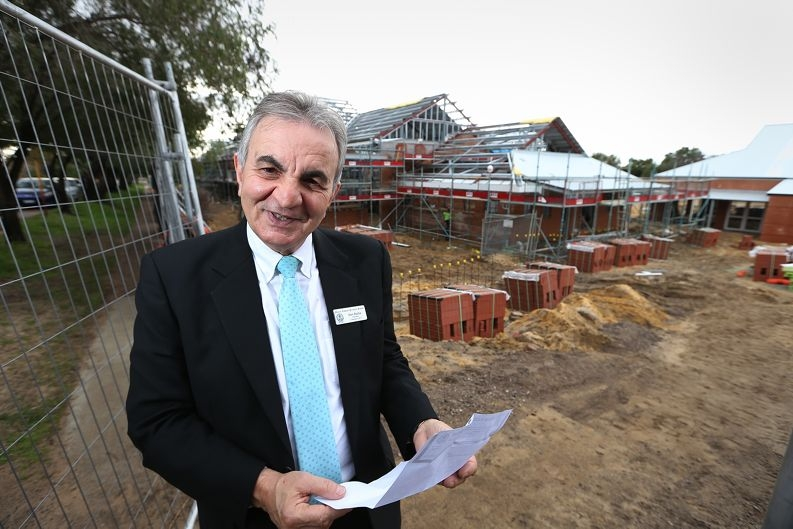 Principal Don Barbas outside new school