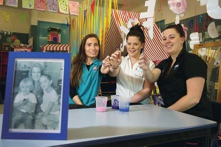 Quinns Beach Care for Kids director Angela Willis (right) with staff Nicola Todd and Rachel Evans, are |organising a fundraiser to help the family of Zoe Rea. Picture: Emma Reeves www.communitypix.com.au d423863