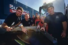 Firemen Joshua Knight, Kurt Mudford and Renny Gosatti with Bunnings staff. Picture: Emma Goodwin d424025