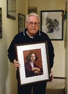 Don Watson with a painting of his mother Fay.