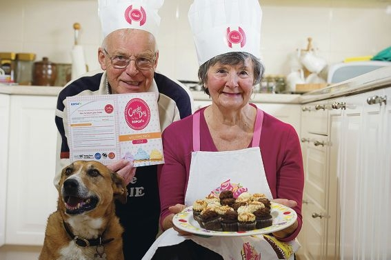 Cupcake Day hosts Mike and Joan Gourley, with their dog Barney.
