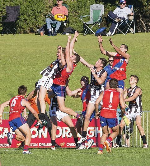 A pack forms as players fly for the ball. Picture: Dan White