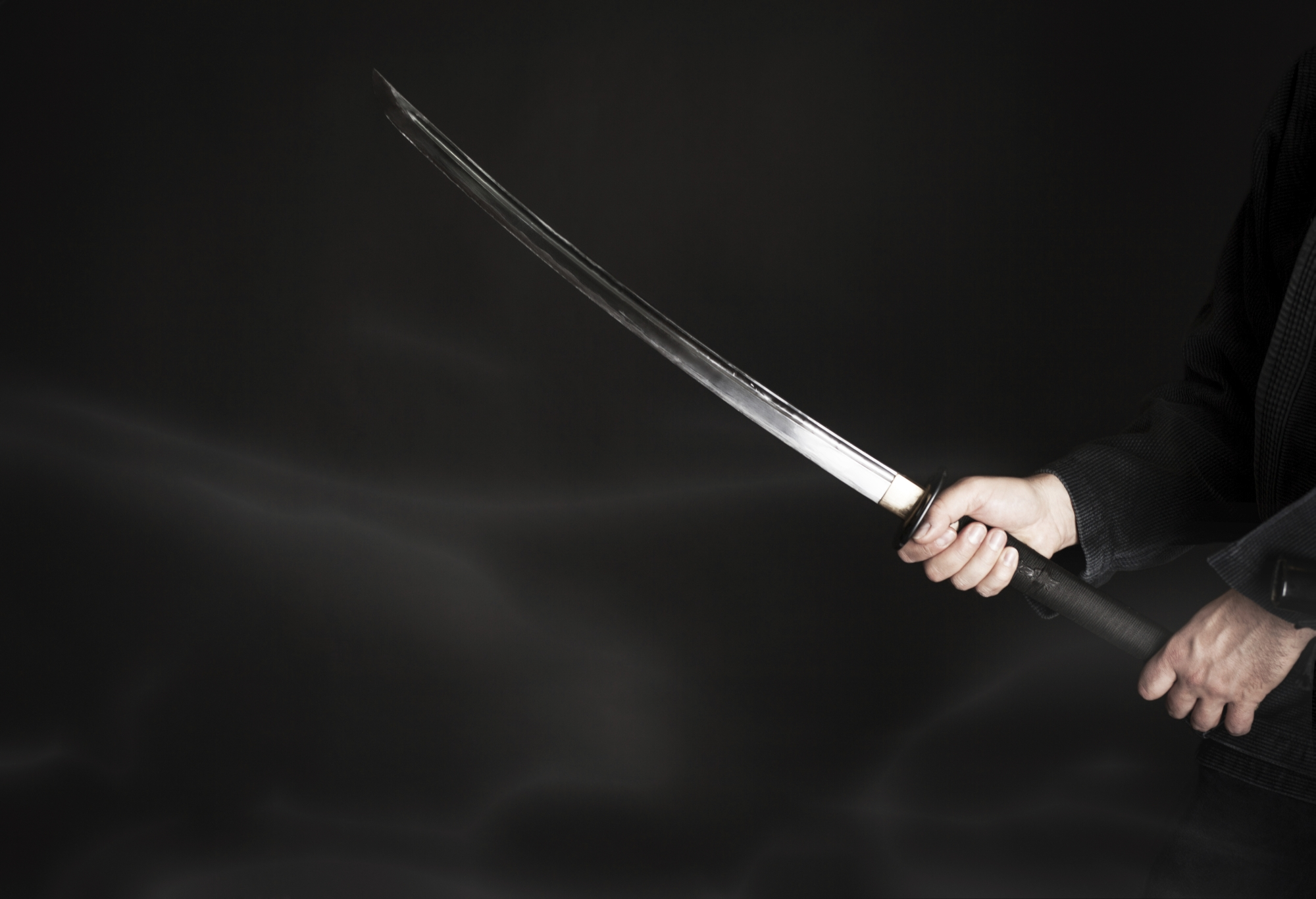 A man allegedly threatened residents with a sword.